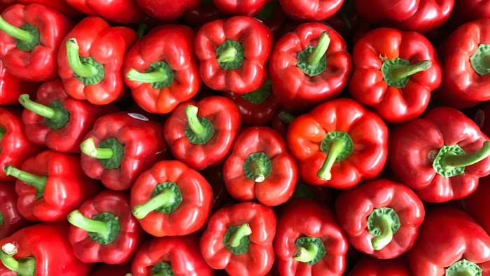 red bell peppers with green stems viewed from above