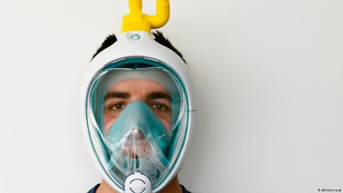 man with a light blue snorkeling mask on a white background