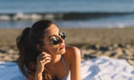 woman with black sunglasses on the beach