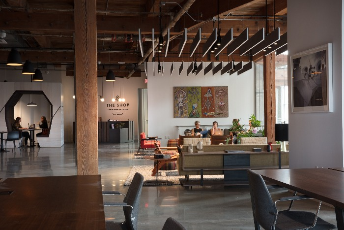 the shop coworking office in new orleans open floor plan wooden beams and roof