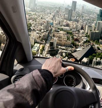 Man driving flying car