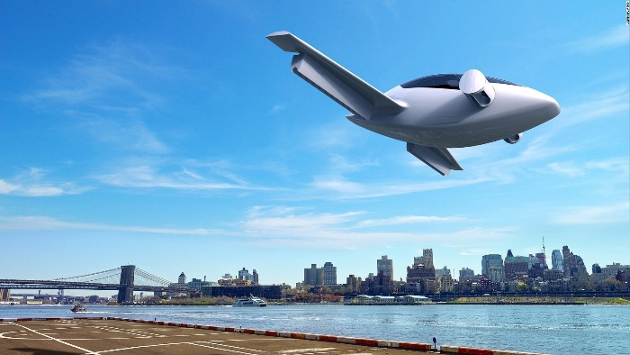 air taxi flying over a river in a blue sky and city skyline