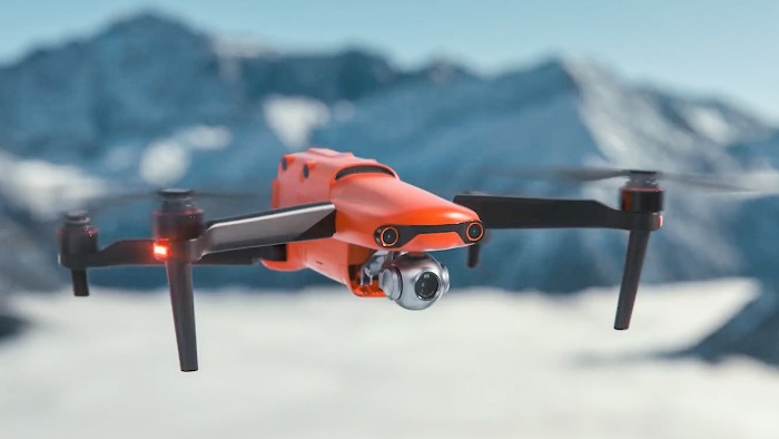 red Autel EVO 2 close up flying in snowy mountains