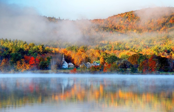 Fall lake scenery autumn foliage and fall mist over the water