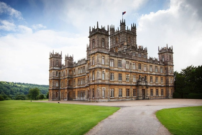 Highclere castle in the background surrounded by green field