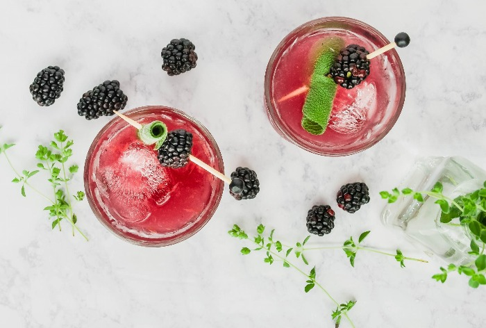 fruit and herb cocktails with blackberries photo from above on a white background