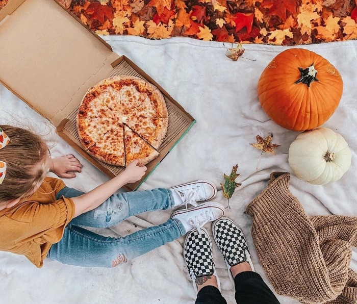 outdoor fall picnic with pizza foliage and pumpkins