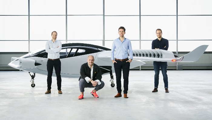 team of engineers demonstrating Lilium Jet flying car model
