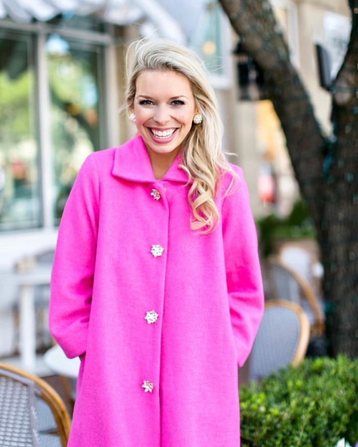 sarah hunt lifestyle influencer in a bright coat smiling outdoors