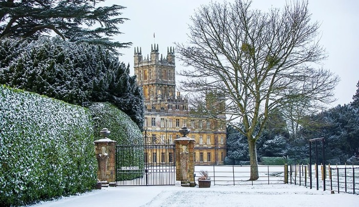 stately home Highclere castle in winter snowy background