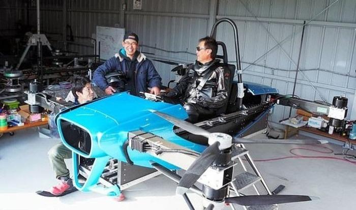 engineers testing blue toyota skydrive