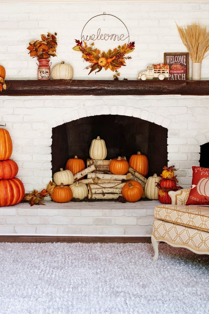 fireplace fall decoration with pumpkins and leaves