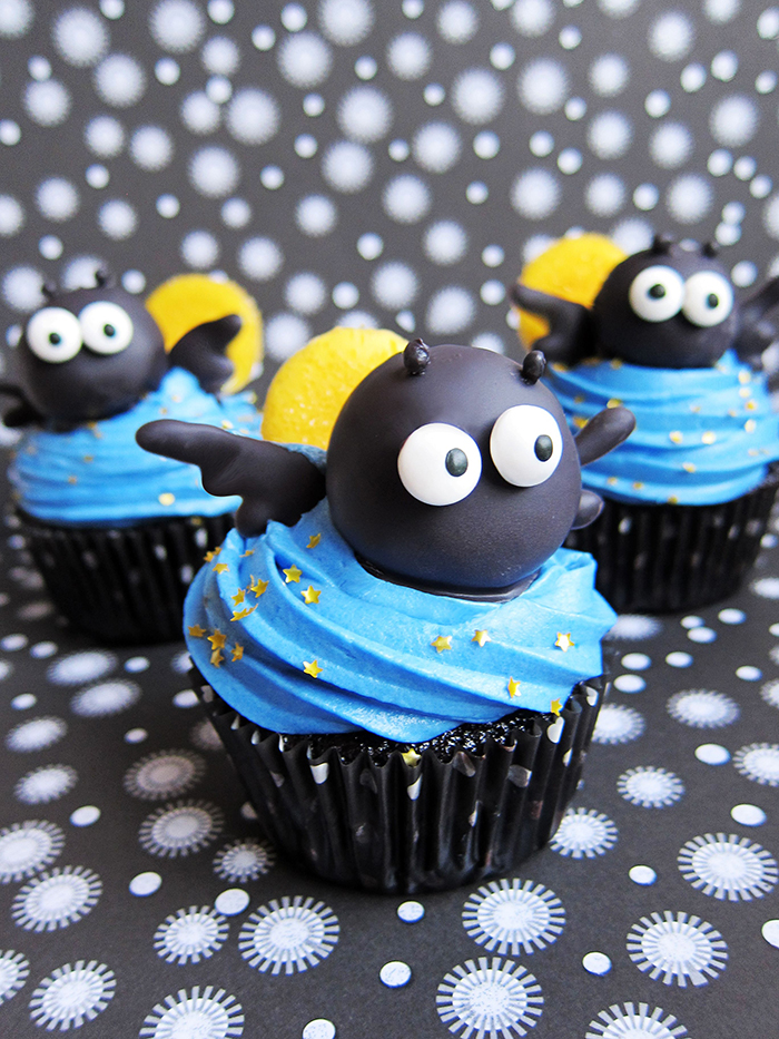 Cute black bat cupcakes with blue topping yellow back and black heads