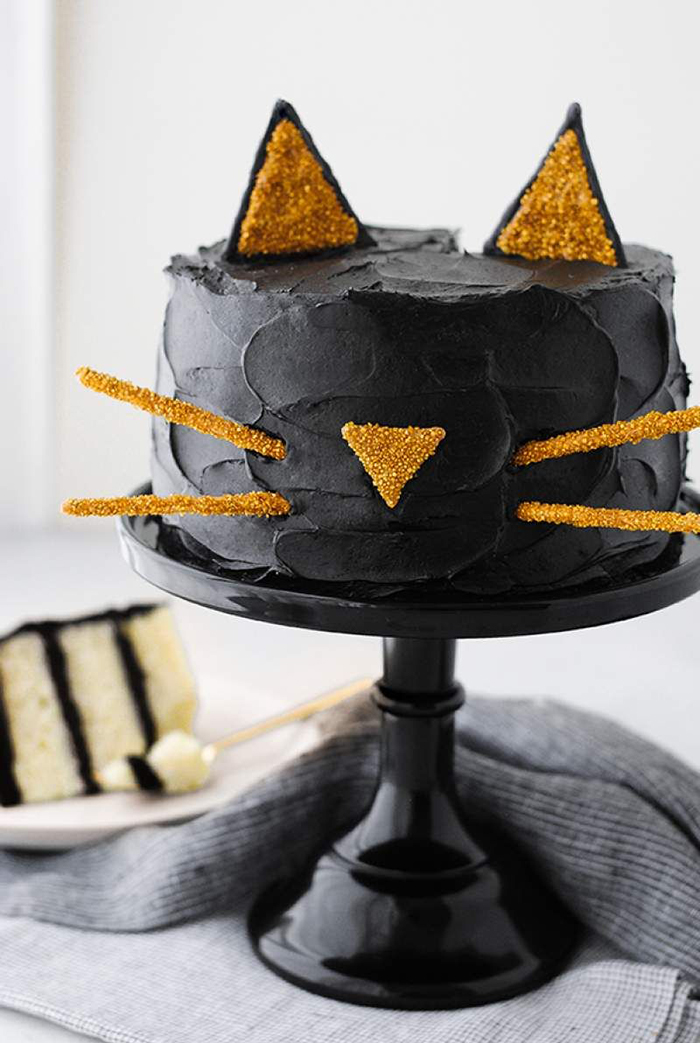 Halloween cat inspirations black cat cake with yellow ears, nose and moustache sticks
