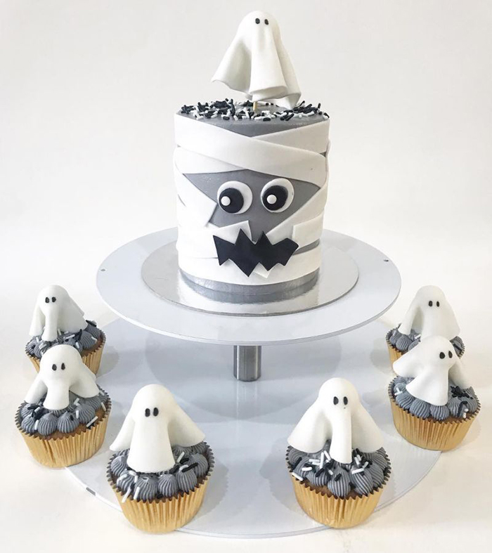 Halloween cake ideas white ghost cupcakes gray cake on a metal stand