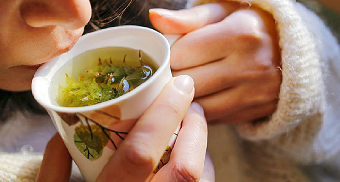best drinks for fall teas natural team woman sipping tea from a mug