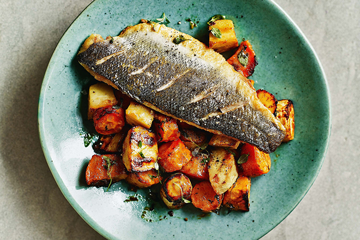 best food for fall fish with vegetables on a light blue plate