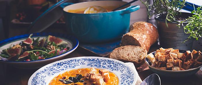 Healthy seasonal foods including salad soup bread