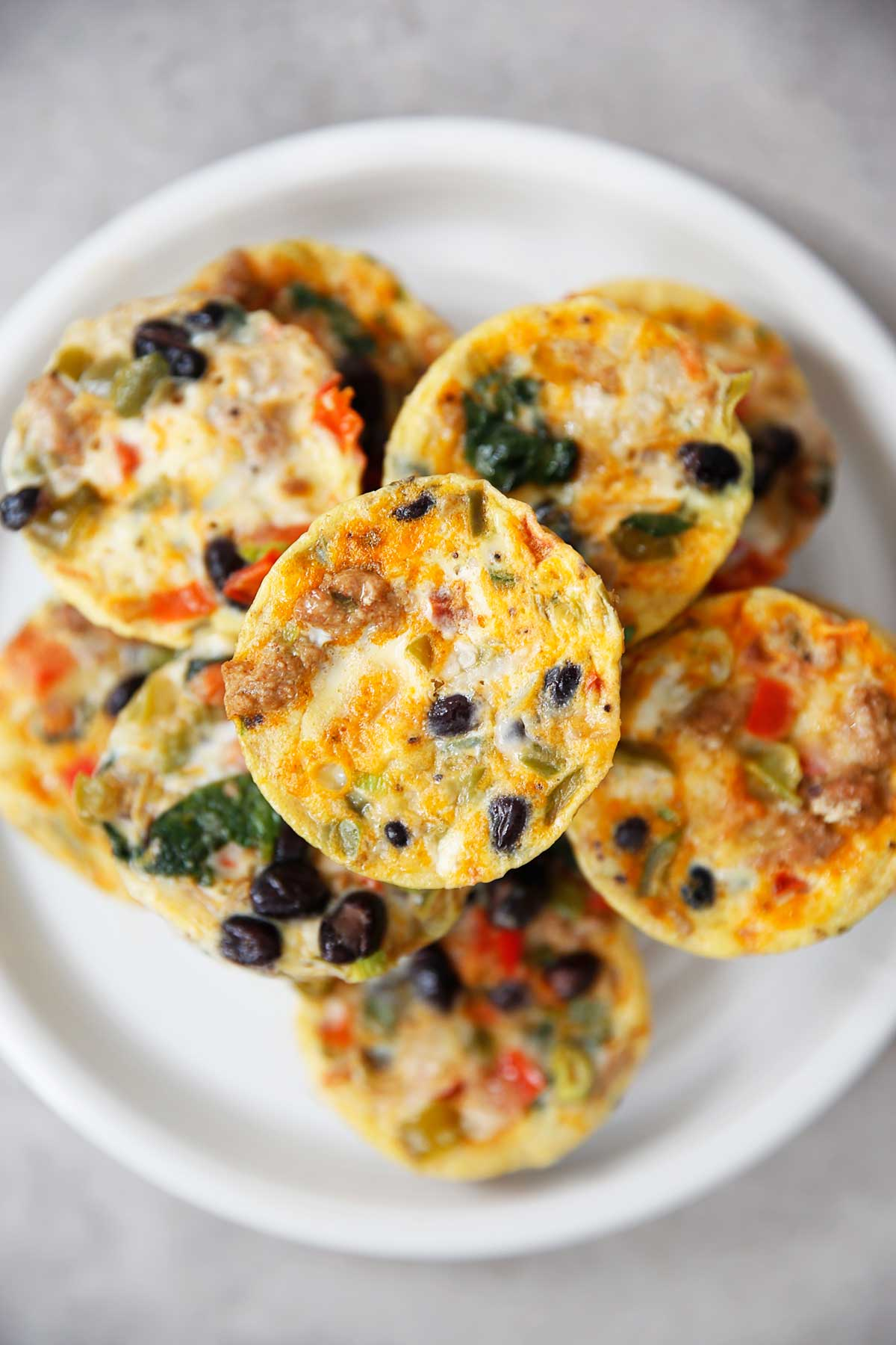 Best fall themed healthy breakfasts egg muffin cups in a white plate