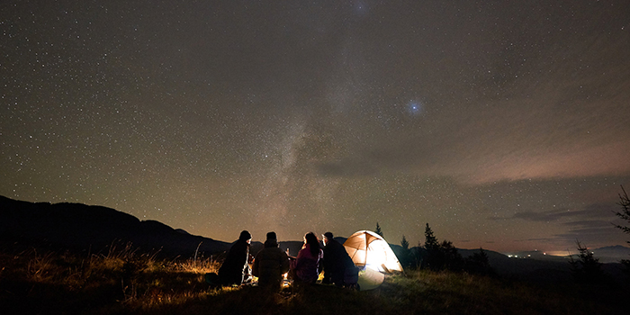 Best new hobbies for winter people gazing around a stent and fire stargazing