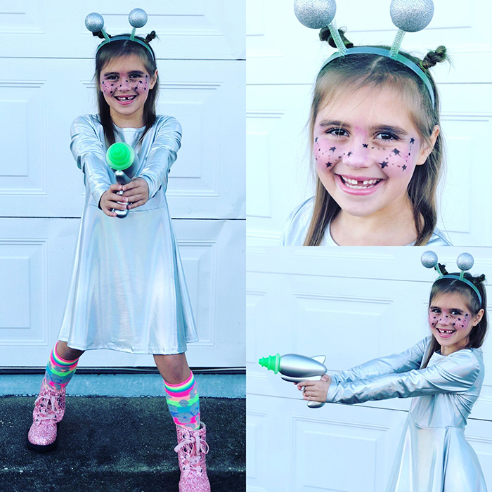 Halloween costume for a child with silver dress pink shoes and a silver gun