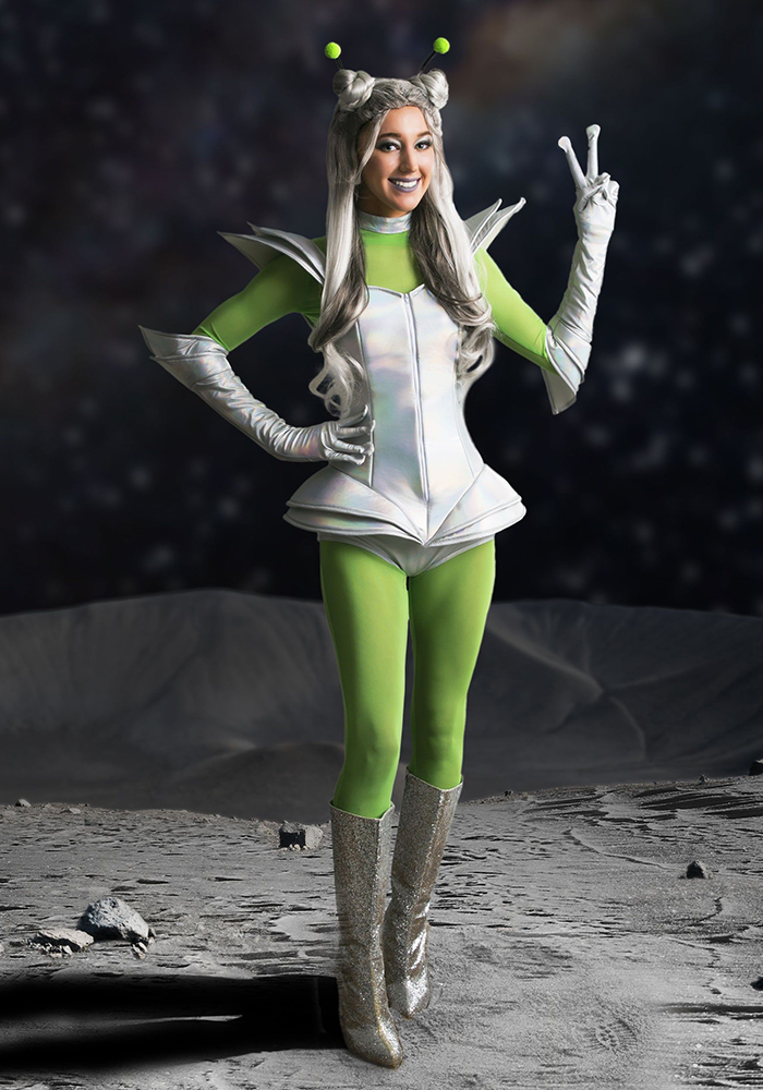 Halloween makeover a girl in a space costume with green pants and silver boots on a moon background