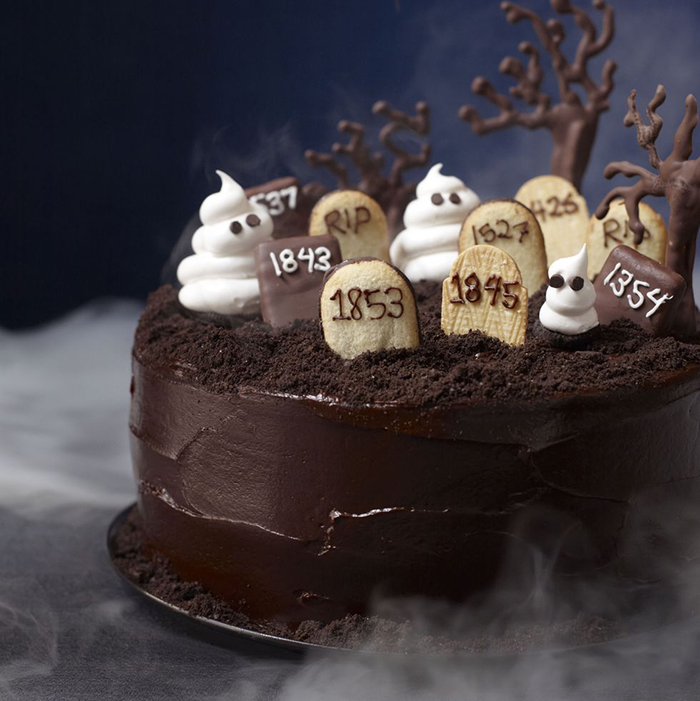 Halloween cake chocolate graveyard cake surrounded by mist and chocolate trees