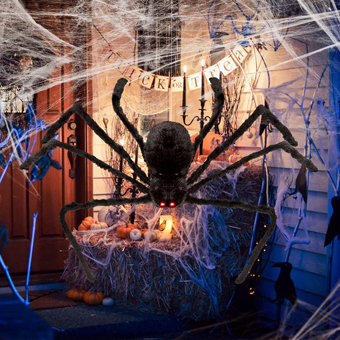 Halloween decor ideas front porch giant black spider and a spider web candles and pumpkins