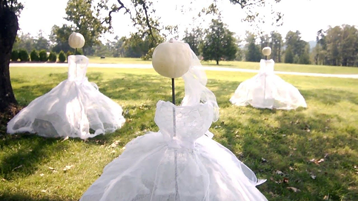 Halloween outdoor ideas white pumpkin heads white dresses ghosts on a lawn