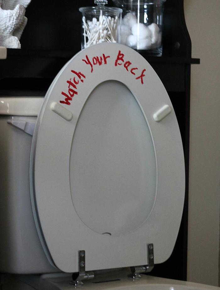 Halloween red lipstick creepy message on the toilet seat