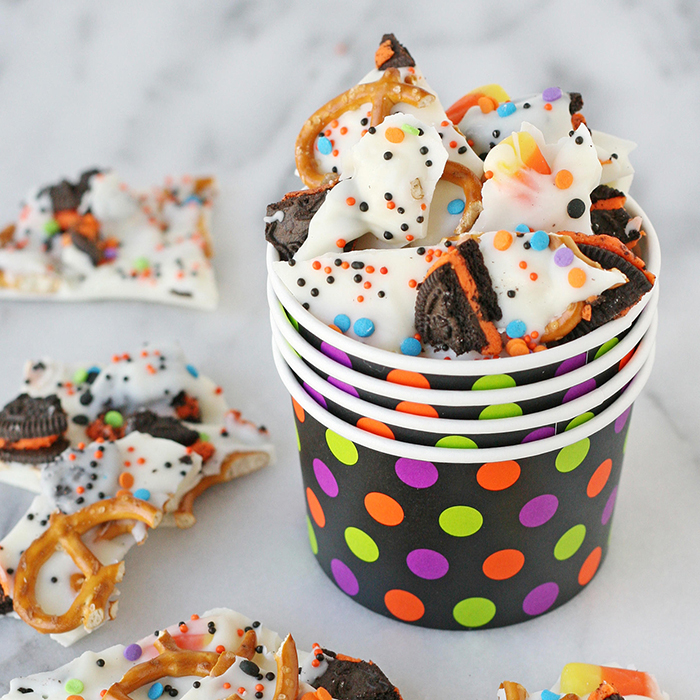 Halloween treats in cardboard cups pretzels and white chocolate