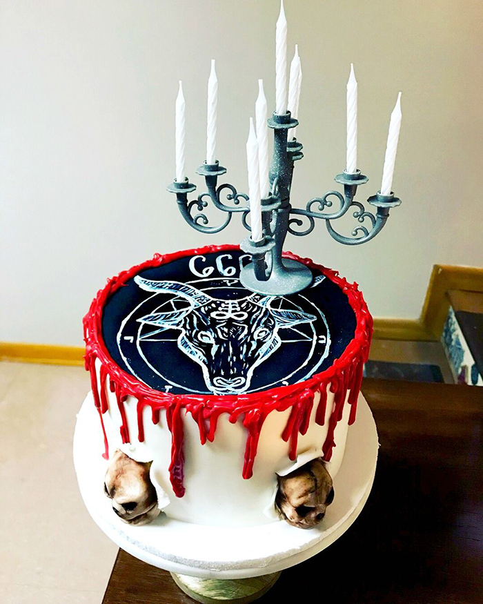 Halloween cake with black top and animal head candle holder