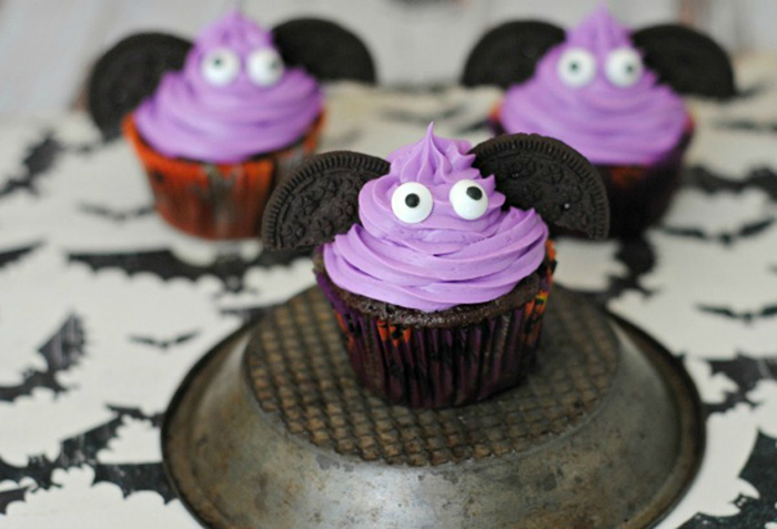 Spookiest bat cupcakes with purple topping, oreo ears and googly eyes