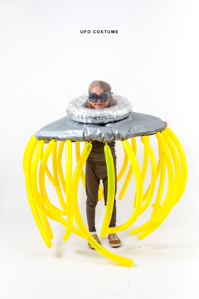 UFO traveler Halloween ideas girl in a space suit with yellow tentacles