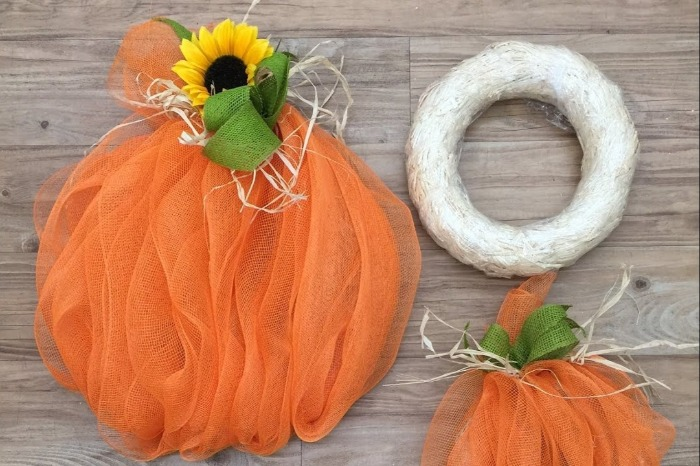 DIY Fall Wreaths deco mesh pumpkin on a table orange with flowers