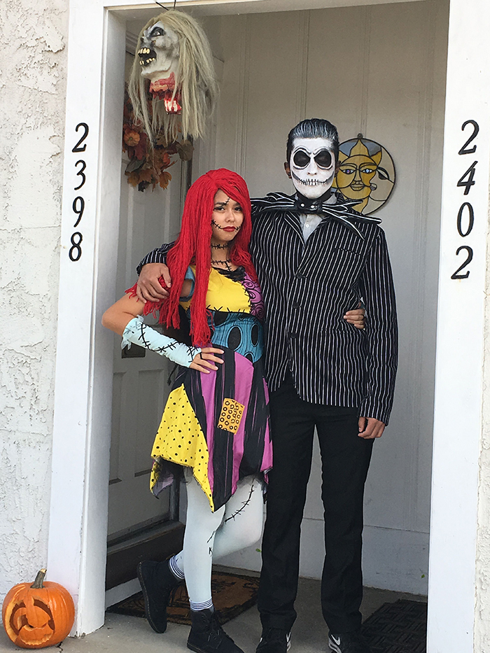 Halloween costumes Jack and Sally at a white front door