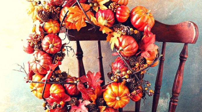 diy thanksgiving wreath fall themed wreath on the back of a chair