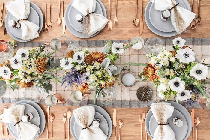 rustic modern thanksgiving table in pale blue with rose gold utencils and ribbon napkins