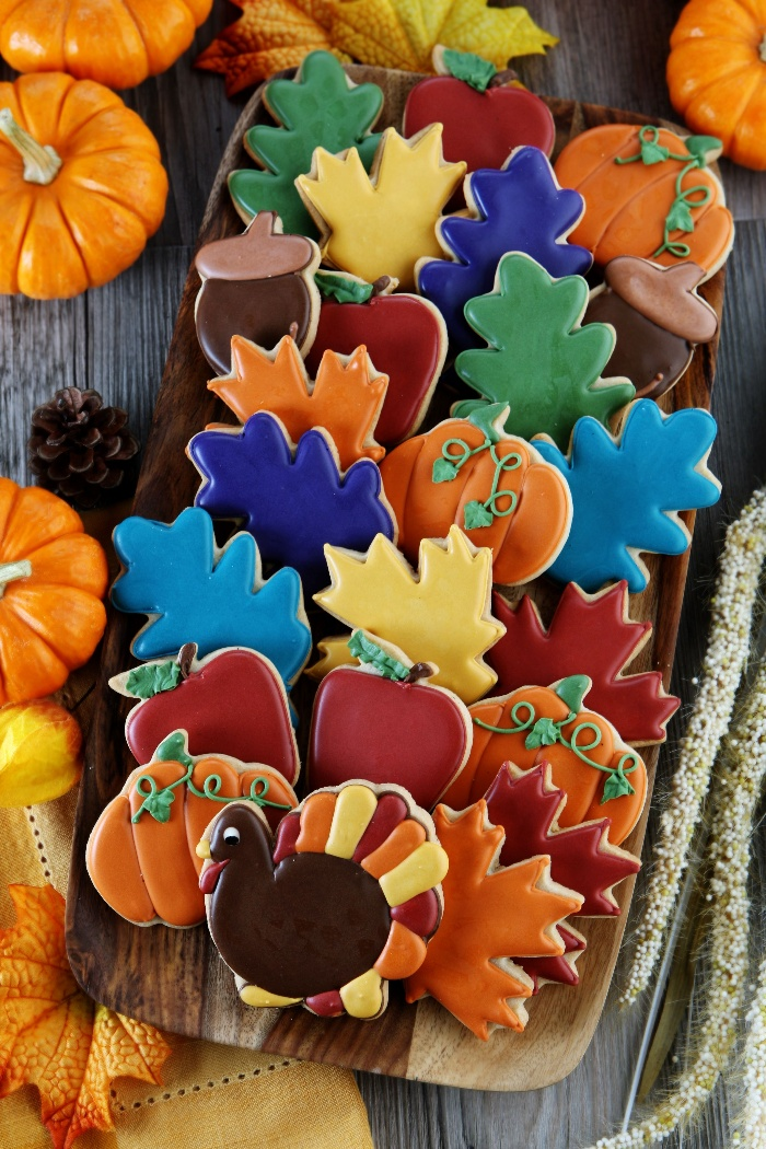 colorful thanksgiving cookies different colors and fall themed shapes