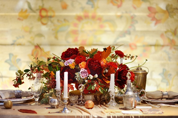 thanksgiving wedding decor stylish centerpiece in red and orange candles and vintage tableware
