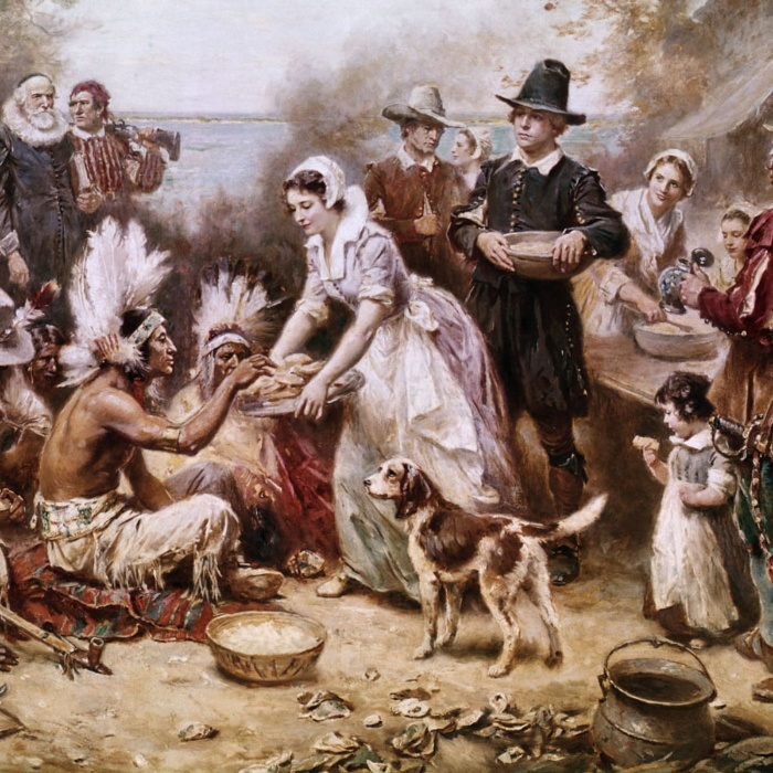 painting depicting thanksgiving celebration in the old times with the native indians