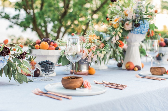 wedding table close up with flower decorations and stylish arrangement