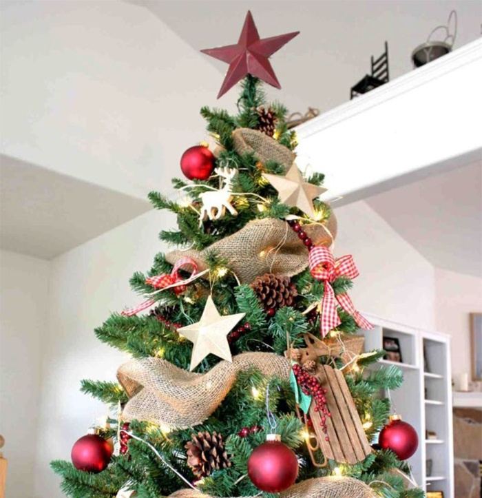 beautiful christmas tree decorated in red and white with a red star on top