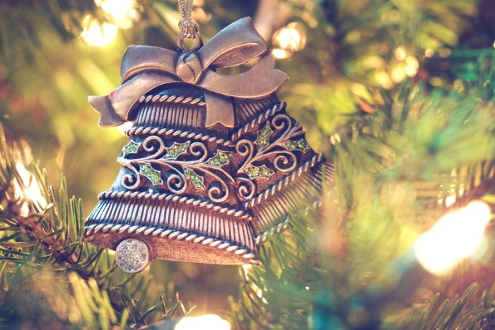 christmas bells ornament hanging on a tree