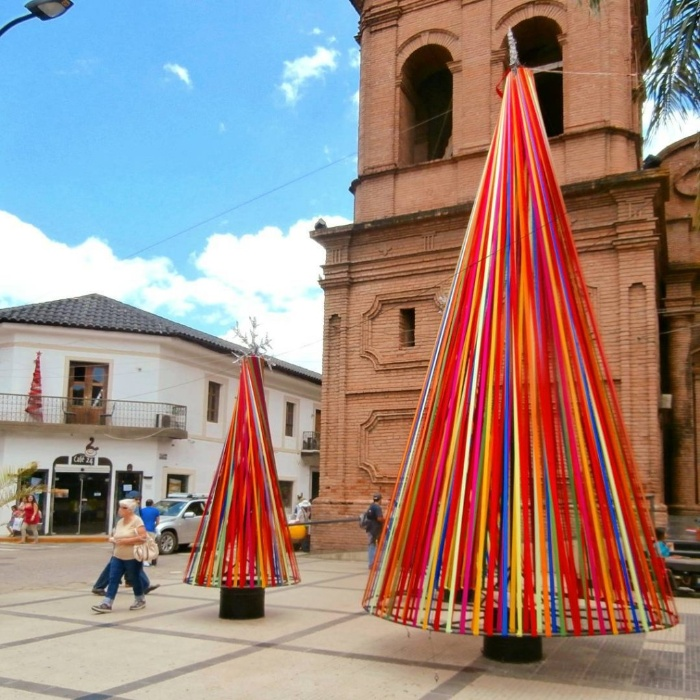 Colorful christmas trees on a square in Bolivia made of ribbons
