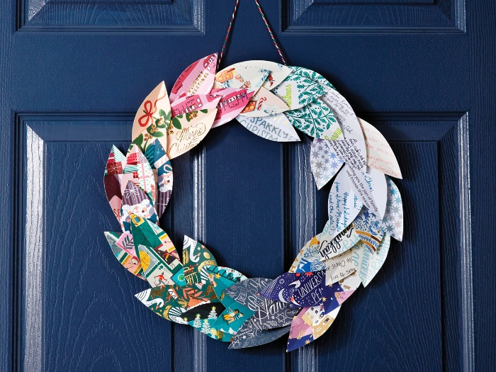christmas cards wreath DIY hanging on a dark blue door