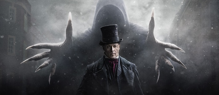 scene from the movie christmas carol old man with a tall hat and a ghost behind him