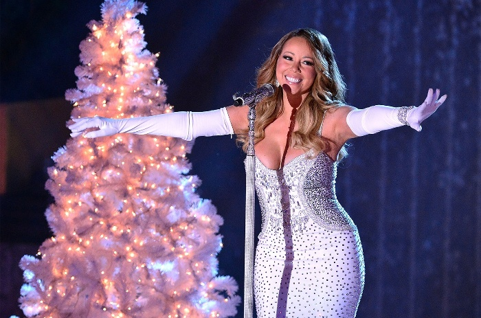 christmas songs mariah carey in a white dress with long gloves on the stage