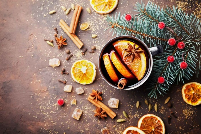 Tastes of winter a table with hot tea oranges cinnamon sticks star anise and orange peels