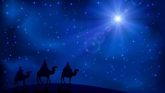 Christmas symbols the guiding star and the three kings on camels
